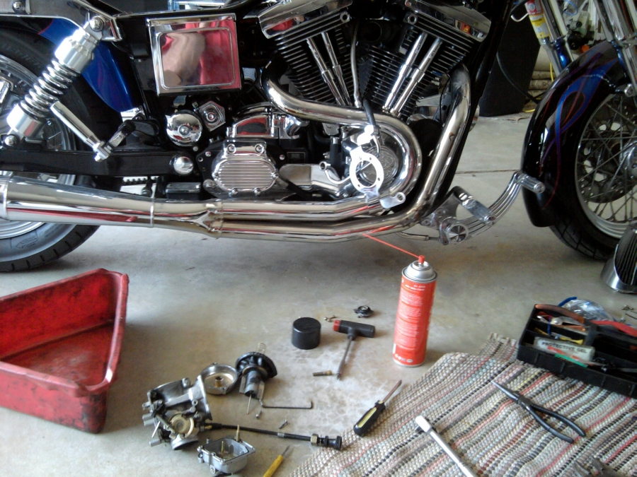 A customer had this custom 1997 Harley Davidson Dyna glide that would not start.  After cleaning, rebuilding the carburetor and replacing the accelerator pump, he was set to go! PMC Super Tuners Inc. mobile motorcycle repair shop specializing in preventive maintenance, carburetor, fuel system issues, diagnostics. Don't tow; we'll help fix your motorcycle, scooter, ATV repair problems on the spot.