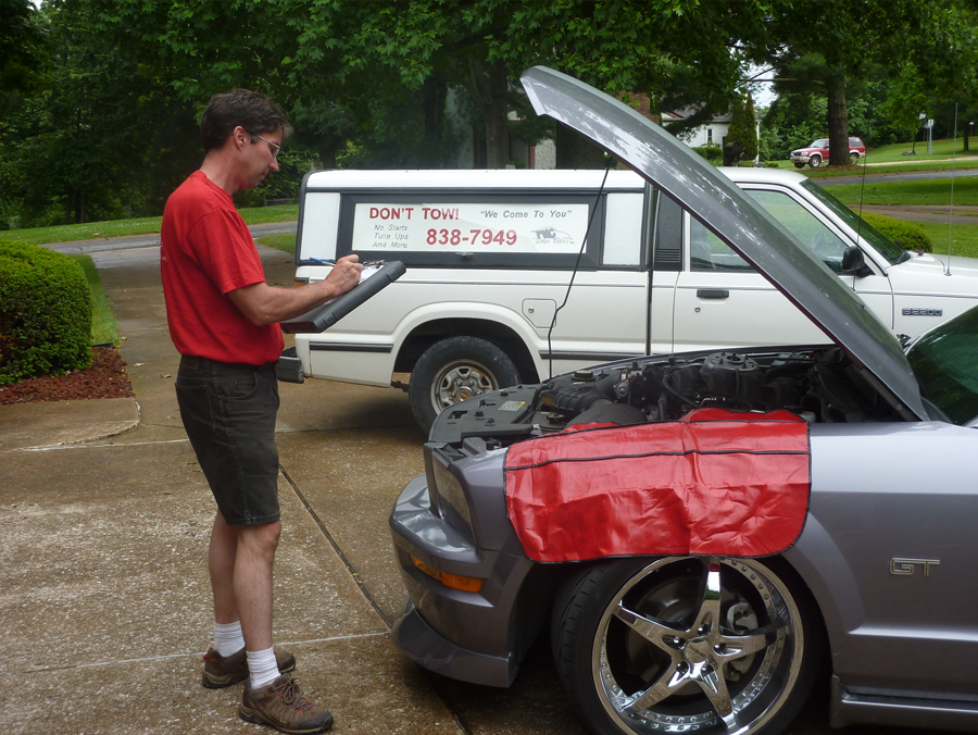 Mobile Auto Repair Shop, Technician performing scheduled preventive maintenance service work on 2007 Ford Mustang GT. We can help to fix the automotive problem on hi performance, sports and classic cars on the spot, no towing necessary.