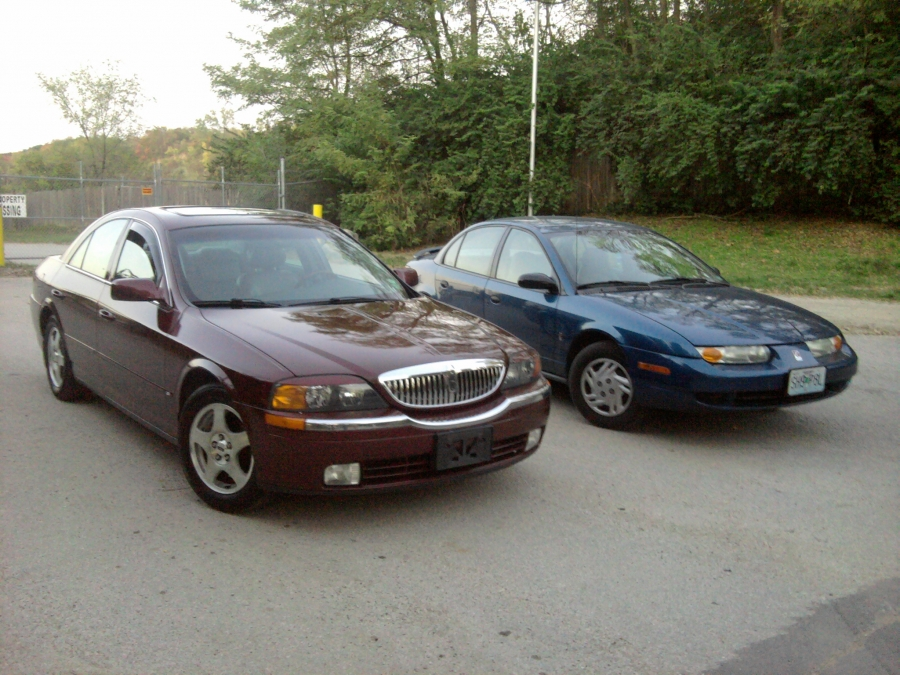 Mobile Car Repair Shop Service, We help our customers to tuneup, diagnose, repair and maintain luxury, sport, economy, autos like this 2000 Lincoln LS and 2001 Saturn SL on the spot, at your home or office.
