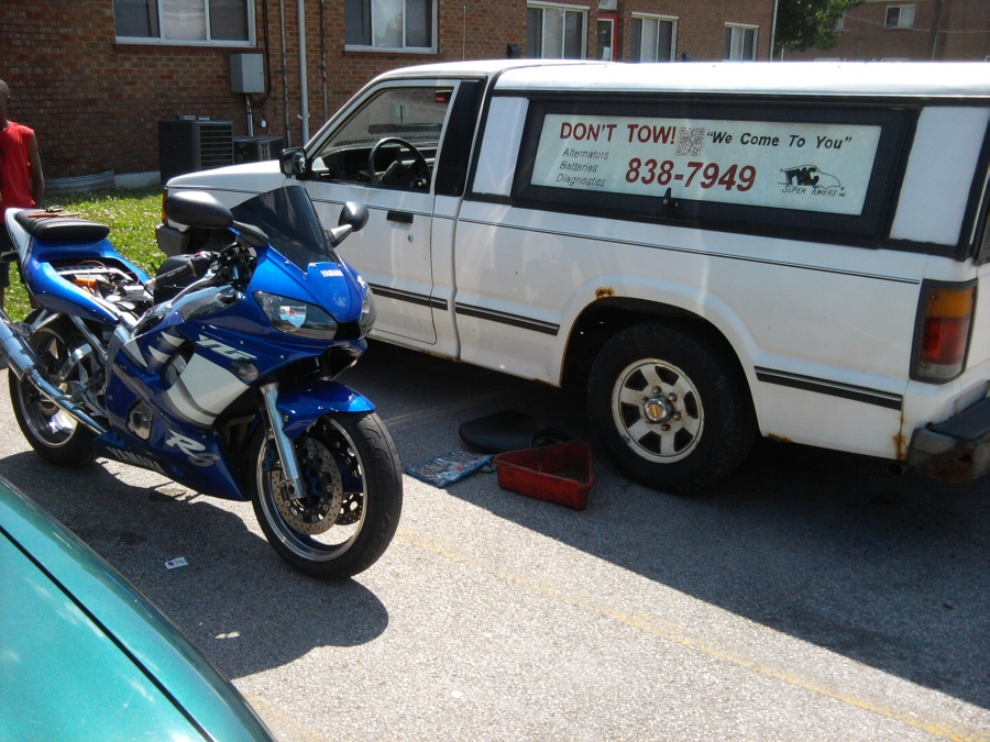Sport bike electrical repair.  After the technician ran diagnostic tests, he found a bad connector under the fuel tank from the ignition switch.  The 2001 Yamaha R6 runs like new after being repaired on site.